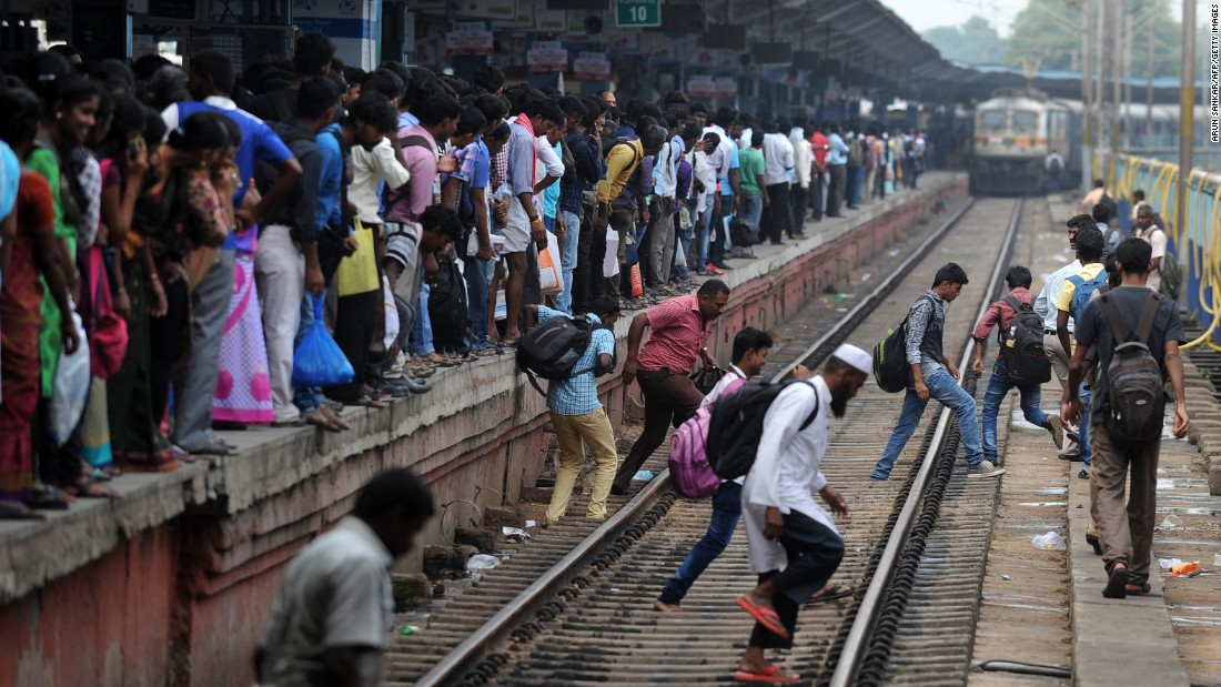 Passengers wait to board a crowded train in Chennai, India, on October 28 on their way to their hometowns ahead of Diwali.