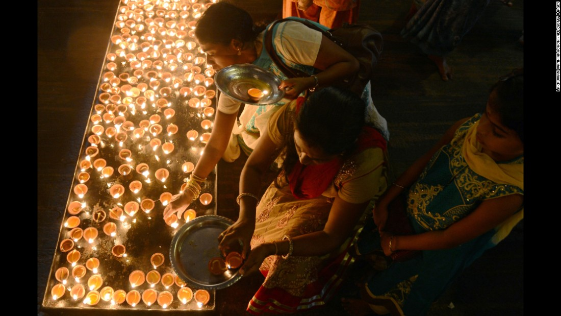 Sri Lankan Hindus light oil lamps during Diwali at a temple in Colombo on October 29.