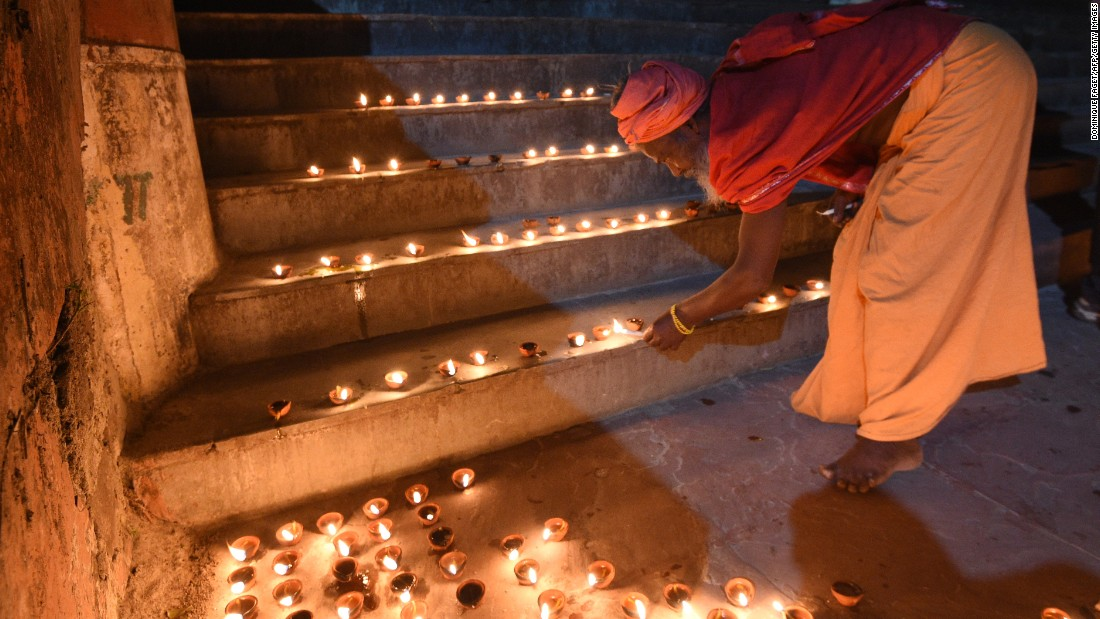 A sadhu, or holy man, lights oil lamps on the banks of the Ganges River during Diwali celebrations in Rishikesh, India October, 29.