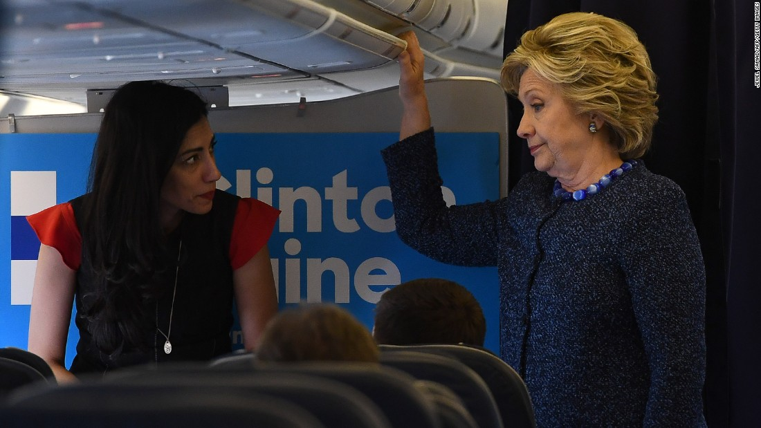 "Democratic presidential candidate Hillary Clinton stands on the plane to Cedar Rapids, Iowa, with Huma Abedin on Friday, October 28. That day, FBI Director James Comey notified Congress about his bureau's decision to review emails potentially related to <a href=""http://www.cnn.com/2016/10/28/politics/fbi-reviewing-new-emails-in-clinton-probe-director-tells-senate-judiciary-committee/index.html"" target=""_blank"">Clinton's personal server. </a>"