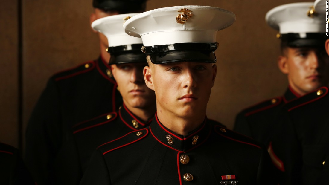 U.S. Marines stand at attention during a funeral service in Los Angeles for Lance Cpl. Carlos A. Segovia-Lopez on Wednesday, October 5. Segovia-Lopez, 19, was fatally shot while on weekend leave.