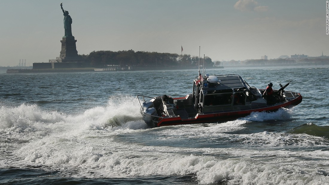 A Coast Guard boat patrols near the Statue of Liberty on Tuesday, October 18.