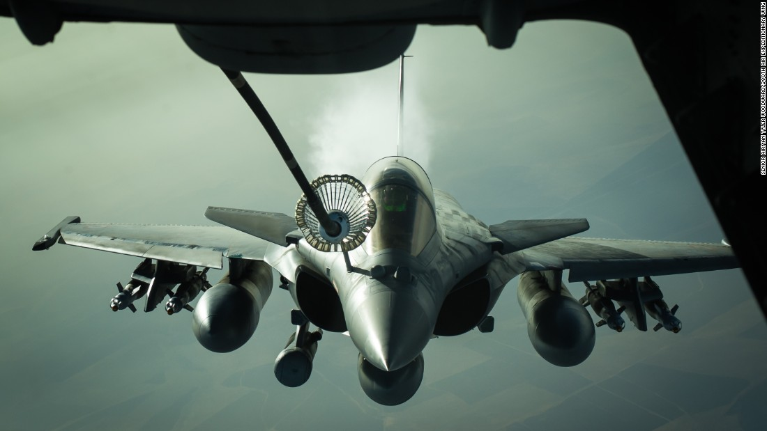 A French fighter jet receives fuel from a U.S. tanker near Iraq on Wednesday, October 26.