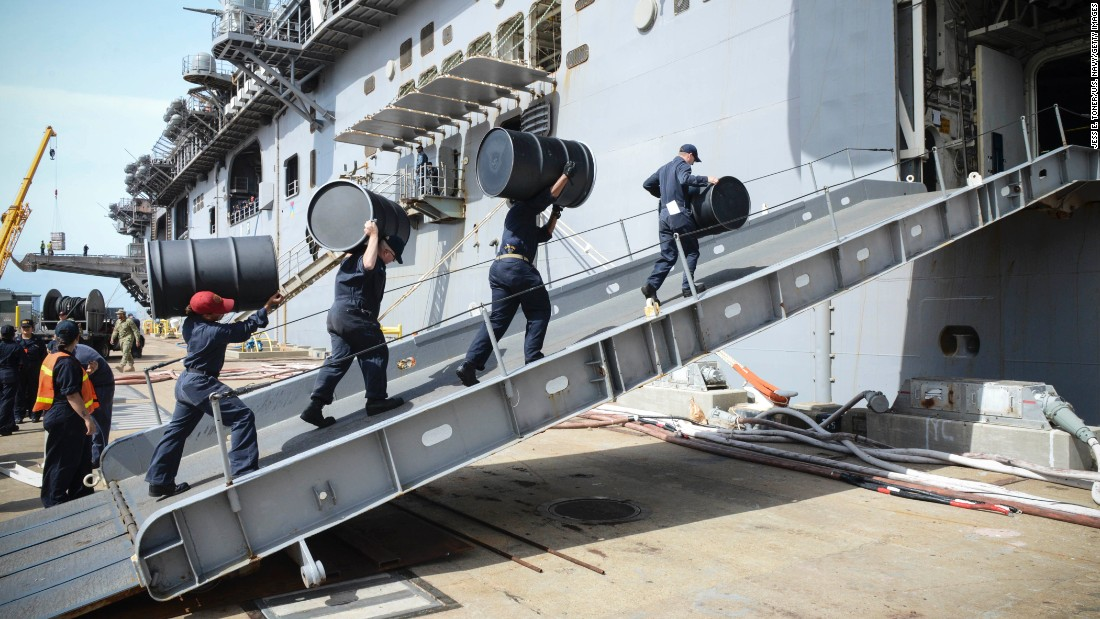 U.S. sailors move supplies onto the USS Iwo Jima in Norfolk, Virginia, on Friday, October 7.