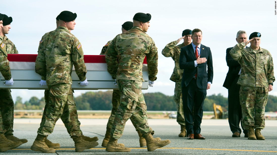 The body of U.S. Army Sgt. Douglas Riney is carried off a plane at an Air Force base in Dover, Delaware, on Friday, October 21. Riney, a 26-year-old from Fairview, Illinois, was killed in Afghanistan. At right is Gen. Mark A. Milley, Army chief of staff. He's next to Army Undersecretary Patrick J. Murphy.