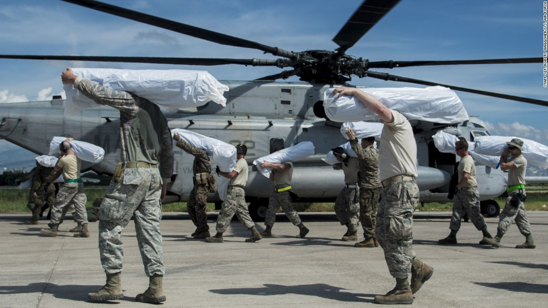 U.S. airmen load humanitarian aid onto a helicopter in Port-au-Prince, Haiti, on Sunday, October 16.
