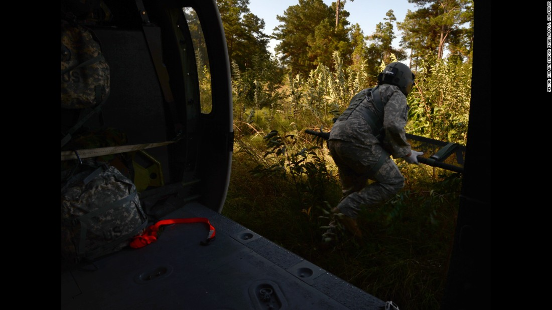 "Sgt. Richard Smith, a medic with the Mississippi Army National Guard, takes part in a training exercise in Gulfport, Mississippi, on Tuesday, October 25. <a href=""http://www.cnn.com/2016/09/30/politics/gallery/us-military-september-photos/index.html"" target=""_blank"">See U.S. military photos from September</a>"