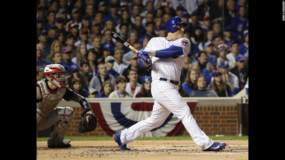 Cubs' Anthony Rizzo hits an RBI single during the first inning of Game 4.