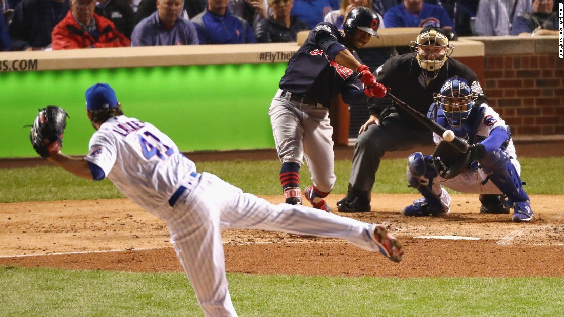 Francisco Lindor of the Cleveland Indians hits a single off of John Lackey of the Chicago Cubs in the third inning in Game 4.