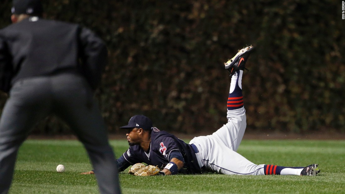 Indians center fielder Rajai Davis can't catch the ball hit by Chicago Cubs' Dexter Fowler during the first inning of Game 4.