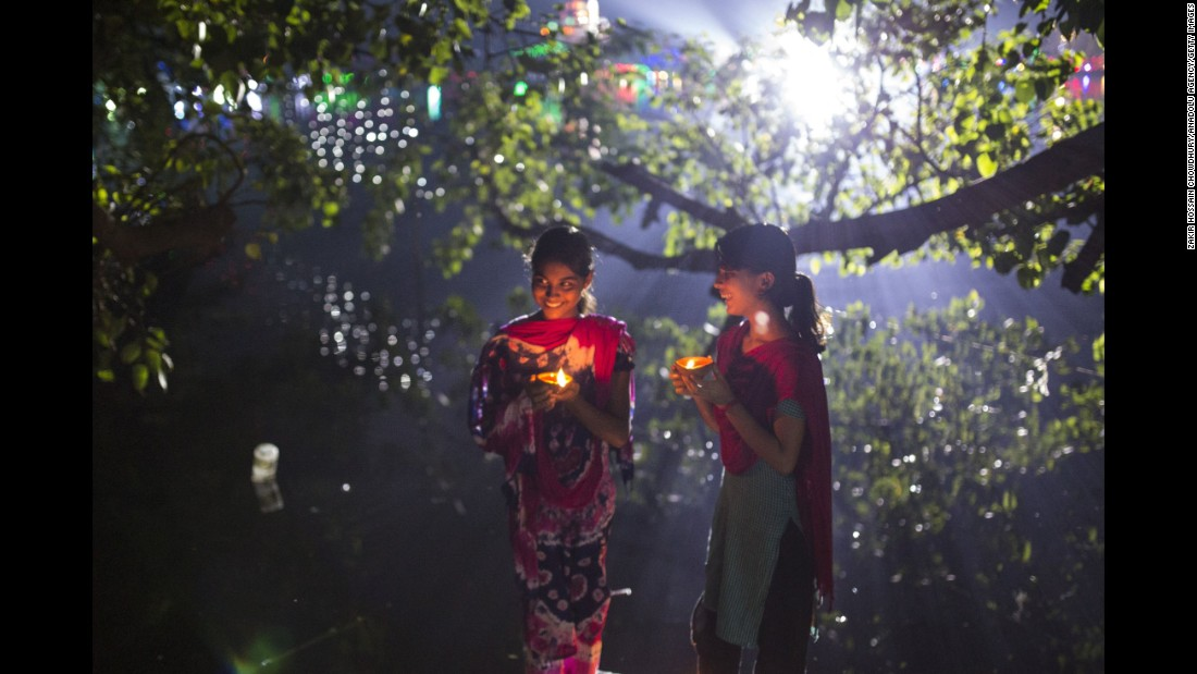 Bangladeshi girls light oil lamps ahead of the Diwali festival in Dhaka on October 29.