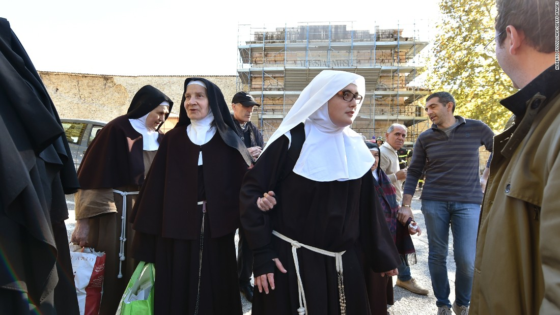 A group of nuns leave the center of Norcia on October 30 after being rescued earlier. Residents ran onto the streets in a panic when the quake struck in the  morning.