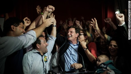 Rio de Janeiro's newly elected mayor, Marcelo Crivella, center, celebrates his win on Sunday.