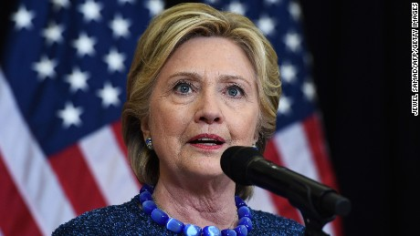 US Democratic presidential nominee Hillary Clinton answers a question during a press conference about the FBI's reopening of a probe into her use of a private email server while secretary of State, in Des Moines, Iowa, on October 28, 2016.
