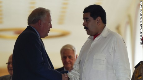 The US undersecretary of state for political affairs, Thomas Shannon, left, greets Venezuelan President Nicolas Maduro on Monday in Caracas.