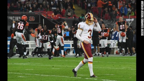 Washington Redskins placekicker Dustin Hopkins reacts after missing a 34-yard field goal in overtime against the Cincinnati Bengals at Wembley Stadium in London. The Redskins and Bengals tied 27-27.