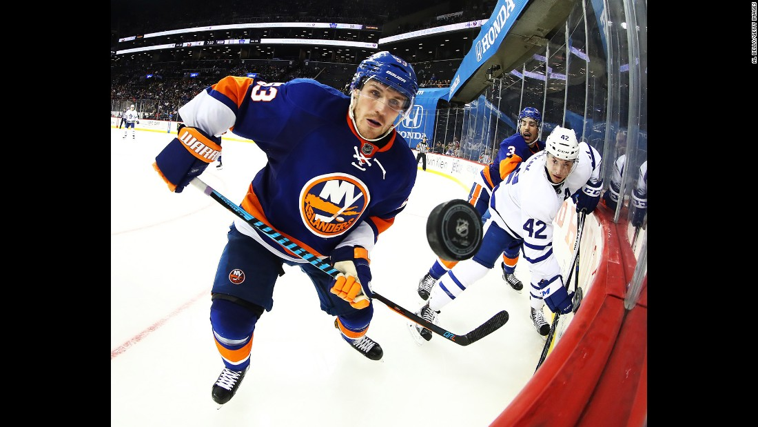 Casey Cizikas, a forward with the New York Islanders, watches the puck during an NHL game against Toronto on Sunday, October 30.
