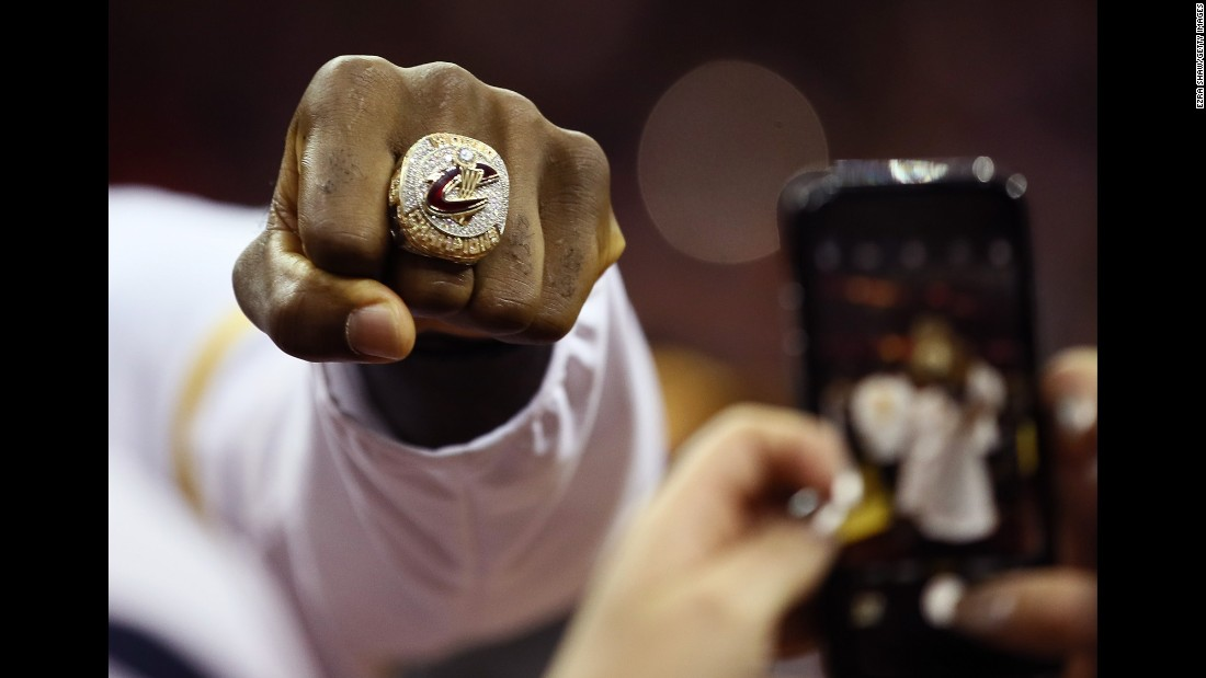 LeBron James shows off the championship ring that he and the rest of the Cleveland Cavaliers received on Tuesday, October 25.
