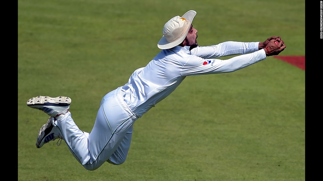 Pakistani cricketer Mohammad Amir catches a ball Monday, October 31, during a Test match against the West Indies in Sharjah, United Arab Emirates.