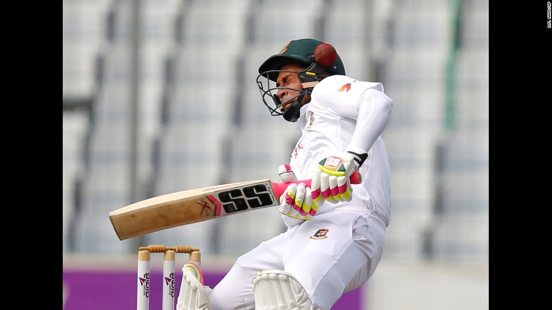 The ball hits the helmet of Bangladesh captain Mushfiqur Rahim as he bats against England in Dhaka, Bangladesh, on Friday, October 28.