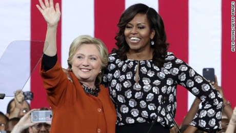 Democratic presidential candidate Hillary Clinton (L) and U.S. first lady Michelle Obama (R) greet supporters during a campaign event at the Lawrence Joel Veterans Memorial Coliseum October 27, 2016 in Winston-Salem, North Carolina. The first lady joined Clinton for the first time to campaign for the presidential election.  (Photo by Alex Wong/Getty Images)