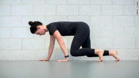 Danielle Johnson, a physical therapist at the Mayo Clinic Healthy Living Program, demonstrates how to crawl for exercise
