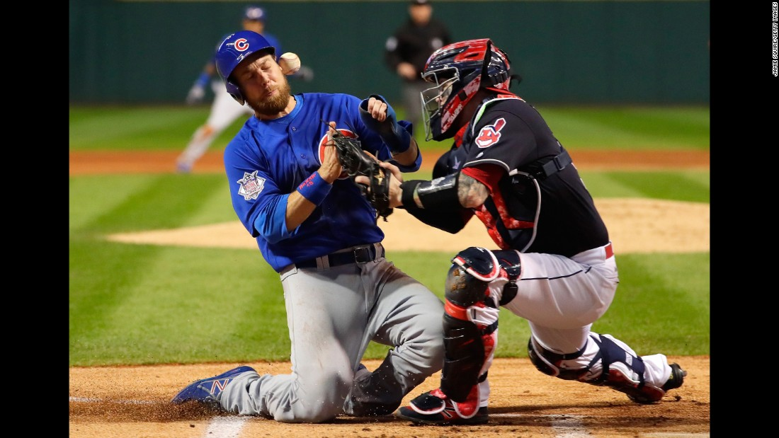 Ben Zobrist of the Cubs collides with the Indians' Roberto Perez in the first inning of Game 6.