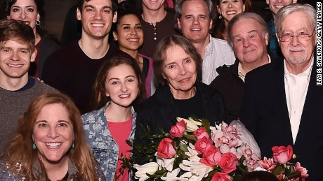 "Natalie Babbitt poses with the cast of ""Tuck Everlasting"" on Broadway in April."