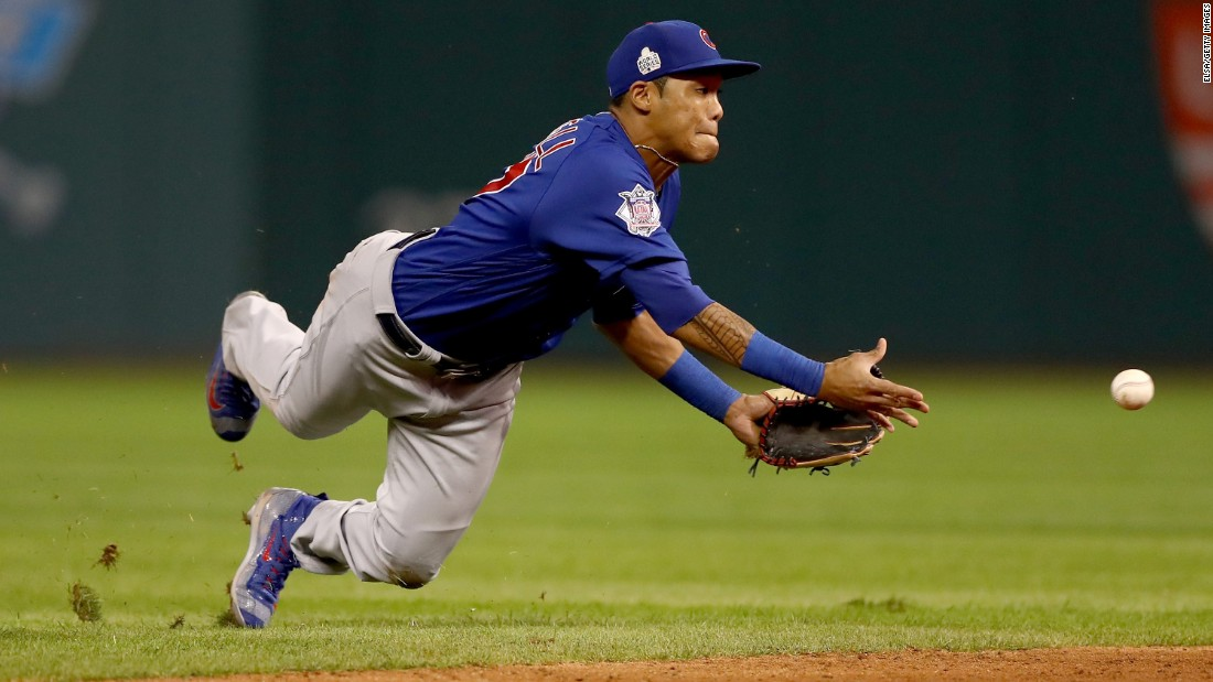 Addison Russell of the Cubs tosses the ball to Javier Baez (not pictured) for a force out in the sixth inning of Game 6.