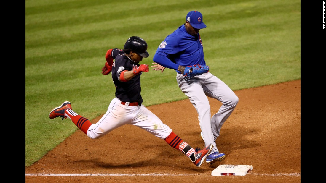 Aroldis Chapman of the Cubs races Francisco Lindor of the Indians to the bag during the seventh inning in Game 6.
