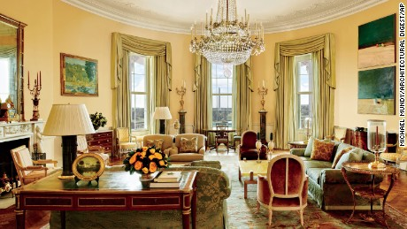 "The image provided by Architectural Digest shows the Yellow Oval Room in the White House in Washington in a cover story about . Designer Michael S. Smith specified a Donald Kaufman paint for the Yellow Oval Room. Artworks by Paul Cézanne and Daniel Garber flank the mantel. Smith mellowed the Yellow Oval Room with smoky browns, greens, golds, and blues. The 1978 Camp David peace accords were signed at the antique Denis-Louis Ancellet desk, front left. President Barack Obama likes to say the White House is the ""people's house."" Architectural Digest photos are giving the public its first glimpse of private areas on the second floor of the White House that Obama, his wife, Michelle, daughters Malia and Sasha and family dogs Bo and Sunny have called home for nearly eight years. (Michael Mundy/Architectural Digest via AP)"