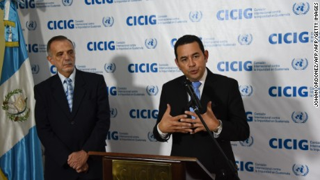 Guatemalan President elect Jimmy Morales (R) speaks next to the Head of the International Commission Against Impunity in Guatemala (CICIG in Spanish), Colombian Ivan Velasquez, after a press conference in Guatemala City on October 28, 2015.     AFP PHOTO / JOHAN ORDONEZ        (Photo credit should read JOHAN ORDONEZ/AFP/Getty Images)