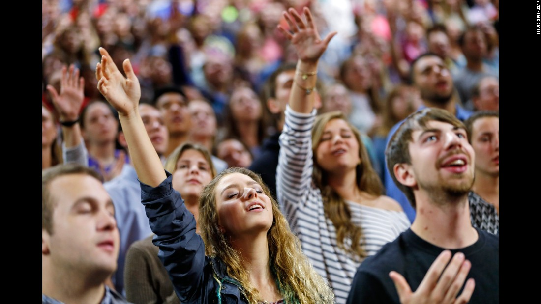 "Liberty University students pray before a Sanders speech in Lynchburg, Virginia, on September 14, 2015. Sanders, who <a href=""http://www.cnn.com/2016/09/28/politics/hillary-clinton-bernie-sanders-millenial-election-2016/"" target=""_blank"">was popular with many young voters</a> during the Democratic primaries, <a href=""http://www.cnn.com/2015/09/14/politics/bernie-sanders-liberty-university-speech/"" target=""_blank"">staunchly defended abortion rights and same-sex marriage</a> during his visit to the largest Christian college in the world."
