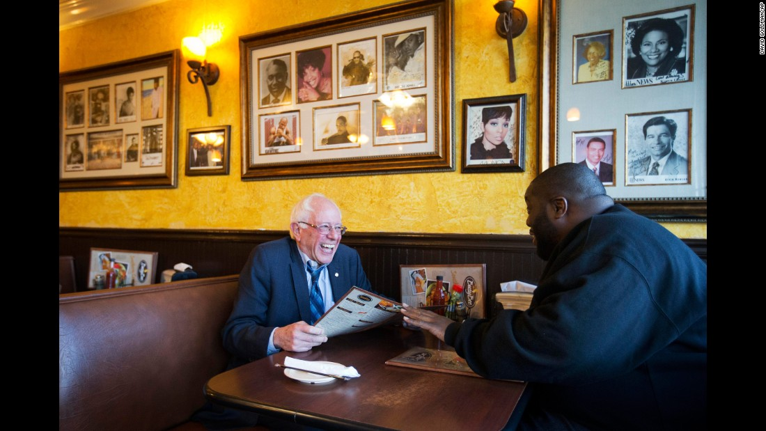 Sanders sits in an Atlanta cafe with rapper Killer Mike on November 23, 2015. The rapper introduced Sanders at a campaign event later that day.