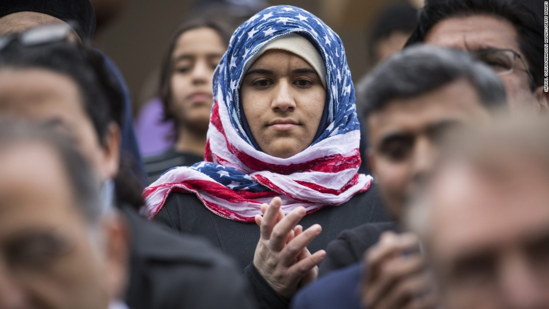 Hidayah Martinez Jaka wears an American flag hijab as Democratic presidential candidate Martin O'Malley speaks at a mosque in Sterling, Virginia, on December 11, 2015.