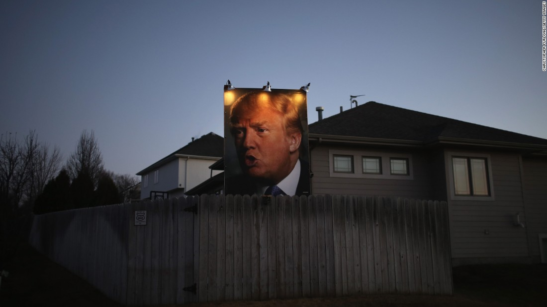 A giant Trump poster is illuminated outside a home in Des Moines, Iowa, on January 28, 2016.