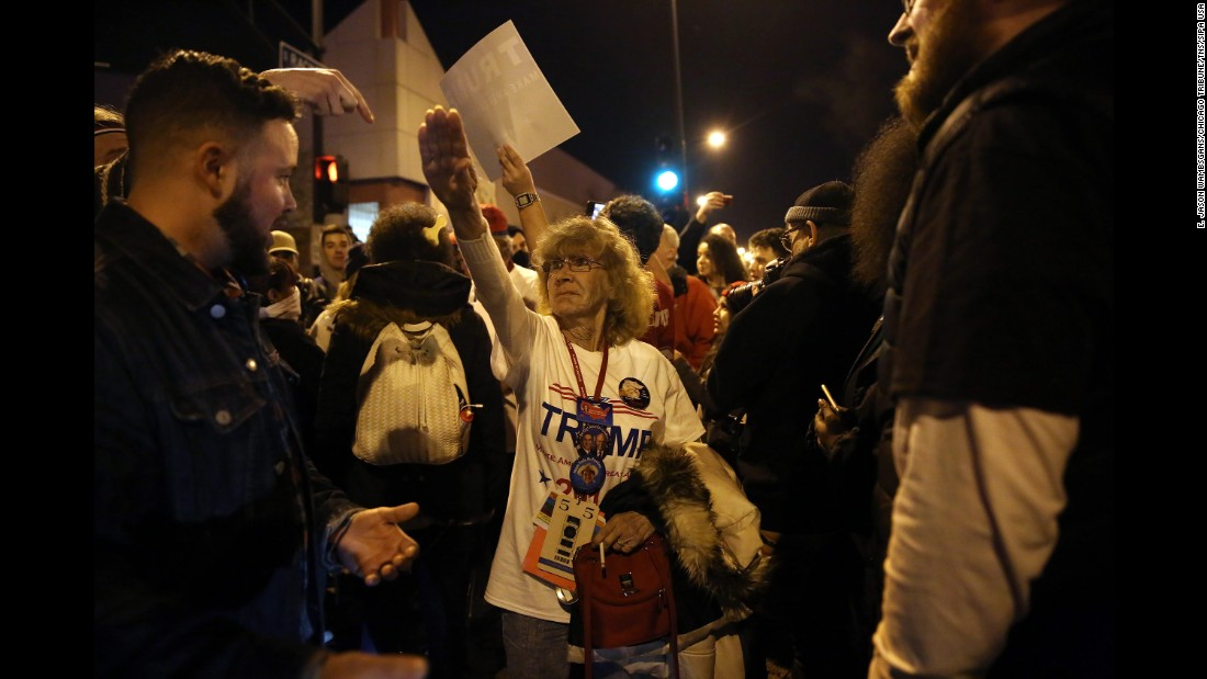 "Trump supporter Birgitt Peterson argues with protesters outside a canceled Trump rally in Chicago on March 11, 2016. Peterson <a href=""http://www.chicagotribune.com/news/ct-birgitt-peterson-trump-rally-met-0313-20160312-story.html"" target=""_blank"">told the Chicago Tribune</a> that she responded with a Nazi-style salute after anti-Trump protesters called her a Nazi. Trump's campaign <a href=""http://www.cnn.com/2016/03/11/politics/donald-trump-chicago-protests/"" target=""_blank"">postponed the rally</a> amid fights between supporters and demonstrators, protests in the streets and concerns that the environment at the event was no longer safe."