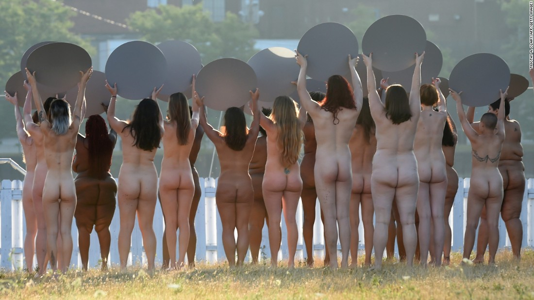 "Naked women hold mirrors as part of a large-scale art installation in Cleveland, across from the site of the Republican National Convention on July 17, 2016. The project by artist Spencer Tunick is called ""Everything She Says Means Everything."""