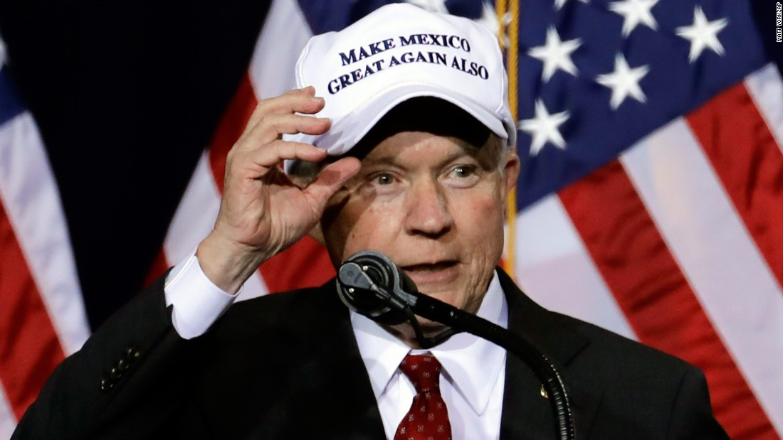 "U.S. Sen. Jeff Sessions shows off his hat while he speaks during a Trump rally in Phoenix on August 31, 2016. <a href=""http://www.cnn.com/2016/09/01/politics/new-trump-hat-trnd/"" target=""_blank"">The hat</a> is related to Trump's campaign slogan, ""Make America Great Again,"" and its debut came hours after Trump traveled south of the border to meet Mexico's President."