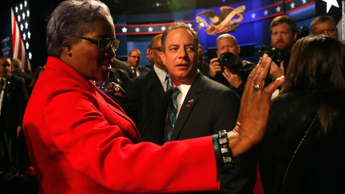 "Donna Brazile, acting chairwoman of the Democratic National Committee, talks with Reince Priebus, chairman of the Republican National Committee, before the vice presidential debate. Brazile <a href=""http://money.cnn.com/2016/10/31/media/donna-brazile-cnn-resignation/index.html"" target=""_blank"">later resigned from her role as a CNN contributor </a>amid fresh revelations that she sent questions to Clinton's campaign in advance of a CNN debate and a CNN-TV One town hall. In a statement, CNN said it was ""completely uncomfortable with what we have learned about her interactions with the Clinton campaign while she was a CNN contributor."" CNN said it ""never gave Brazile access to any questions, prep material, attendee list, background information or meetings in advance of a town hall or debate."""