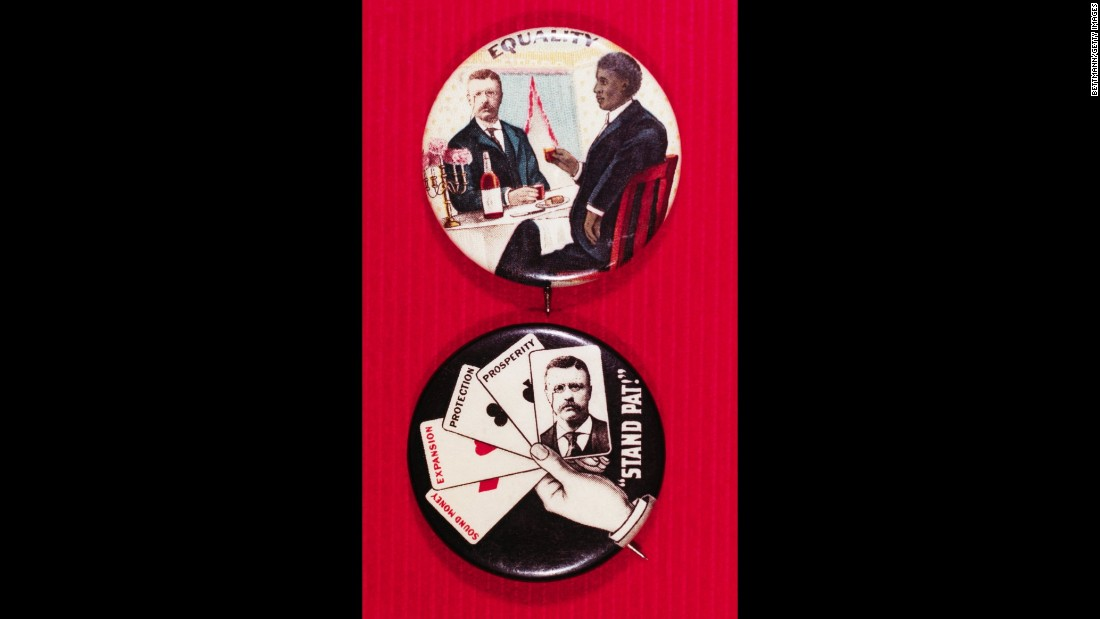 "These buttons are from President Theodore Roosevelt's re-election campaign in 1904. On the top is a button for racial equality. On the bottom is a poker hand with the term ""stand pat,"" meaning to play one's hand without drawing new cards."