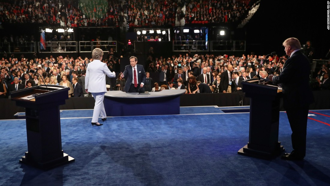 "Clinton walks toward moderator Chris Wallace at the end of <a href=""http://www.cnn.com/2016/10/19/politics/gallery/final-presidential-debate/index.html"" target=""_blank"">the third and final presidential debate</a> on October 19, 2016. There was no handshake between her and Trump."