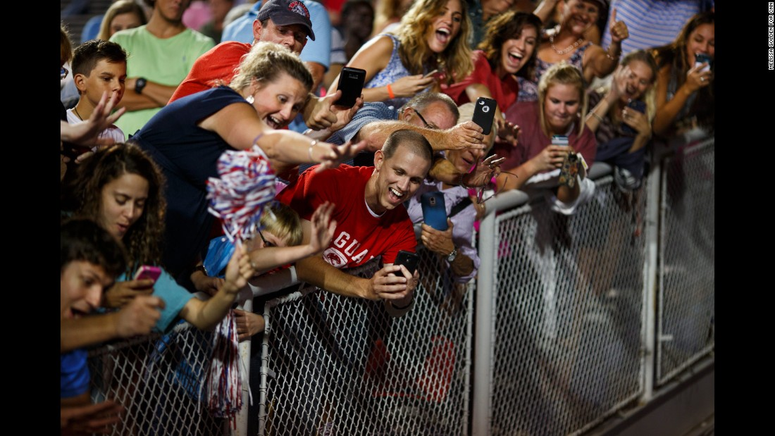 "Trump supporters take photos of Trump as he leaves a rally in Mobile, Alabama, on August 21, 2015. The rally <a href=""http://www.cnn.com/2015/08/22/politics/gallery/trump-rally-alabama/index.html"" target=""_blank"">was held in a football stadium</a> to accommodate 30,000 supporters."