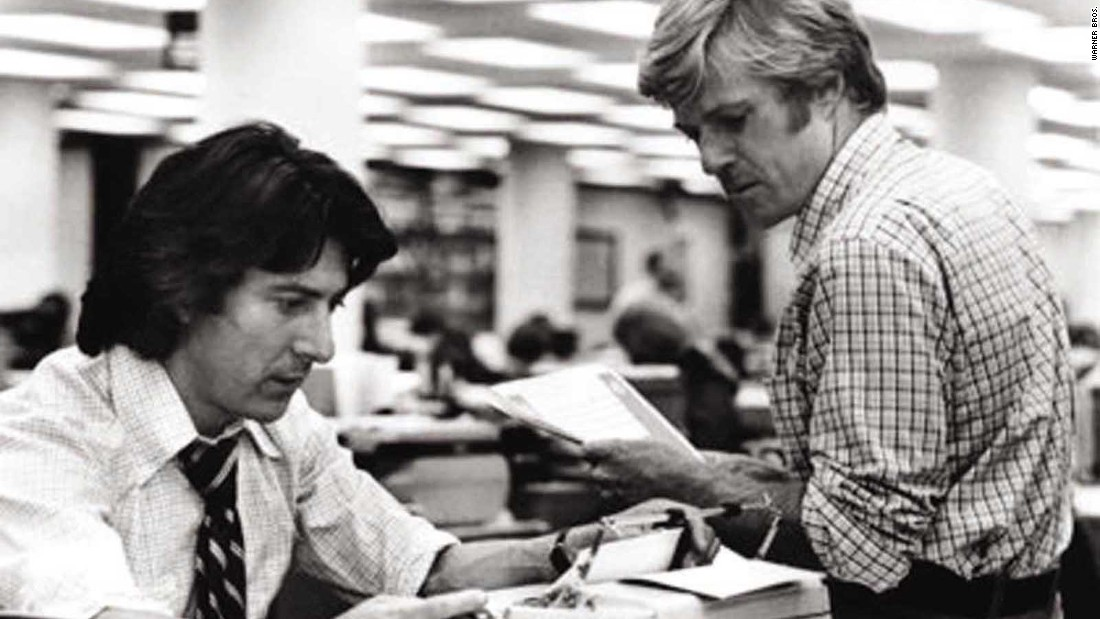 "Robert Redford and Dustin Hoffman as star as Bob Woodward and Carl Bernstein as they investigate the Watergate scandal in <strong>""All the President's Men."" </strong>"