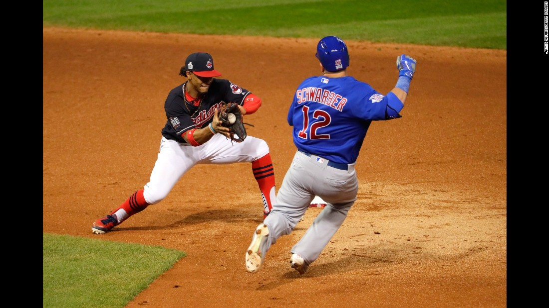 Francisco Lindor of the Indians tags out Kyle Schwarber of the Cubs during the third inning of Game 7.