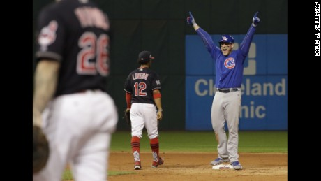 Chicago Cubs' Anthony Rizzo reacts after teammate Kris Bryant scored on Rizzo's hit during the fifth inning of Game 7 of the Major League Baseball World Series against the Cleveland Indians Wednesday, Nov. 2, 2016, in Cleveland. (AP Photo/David J. Phillip)