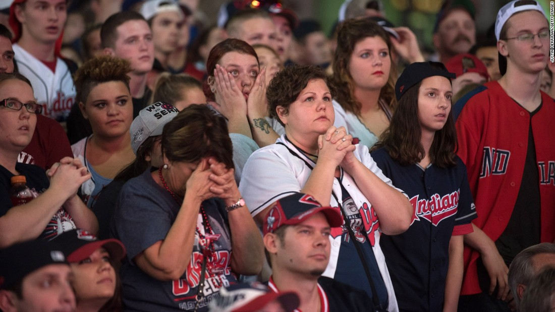 Indians fans react as they watch outside of Progressive Field during Game 7.