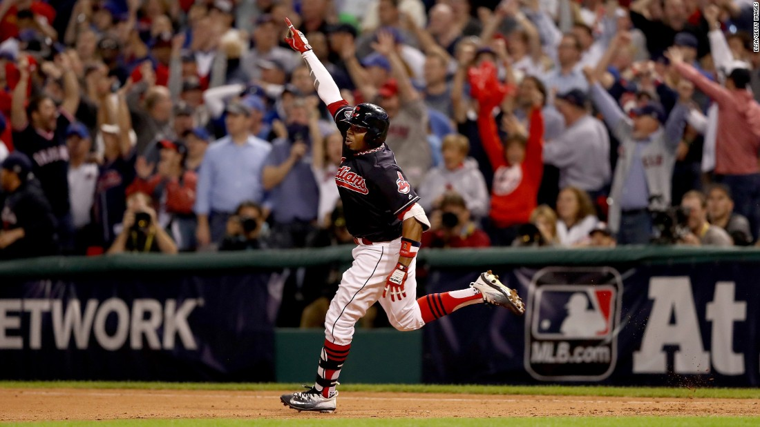 Rajai Davis of the Indians celebrates after hitting a two-run homer during the eighth inning to tie the Game 7 at 6-6.