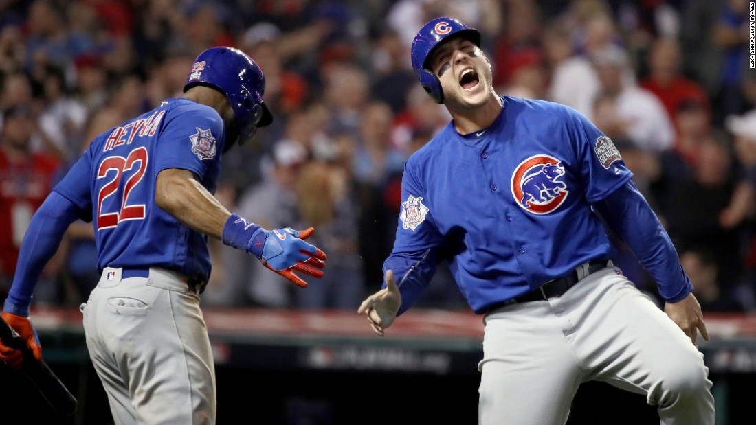 Anthony Rizzo of the Cubs celebrates with Jason Heyward after scoring a run in the tenth inning of Game 7.