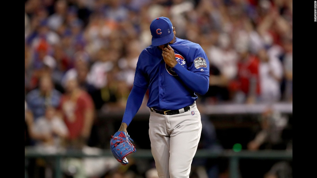 Aroldis Chapman of the Chicago Cubs reacts after Rajai Davis of the Cleveland Indians (not pictured) hit a two-run homer during the eighth inning to tie the game 6-6 in Game 7.